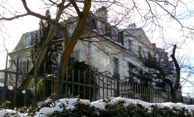 The Chateau des Brouillards Montmartre Alée des Bouillards Paris 75018. A large 18th century classical town house set in a small garden with trees. The scene is in winter with some snow.