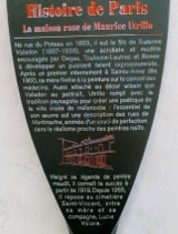 The metalic information panel put up by the Mayor of Paris outside the Maison Rose (Pink House) in Montmartre. The text is in French and is translated in the body of the page text.