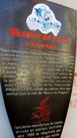 The metalic information panel put up by the Mayor of Paris outside the Bateau Lavoir artists studios in Montmartre. The text is in French and is translated in the body of the page text.