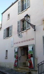The oldest standing building in Montmartre houses the Montmartre Museum 12 Rue Cortot Paris 75018. The building features typical wooden Parisian shutters and a sign above the door proclaiming the Musee de Montmartre (Montmartre Museum)
