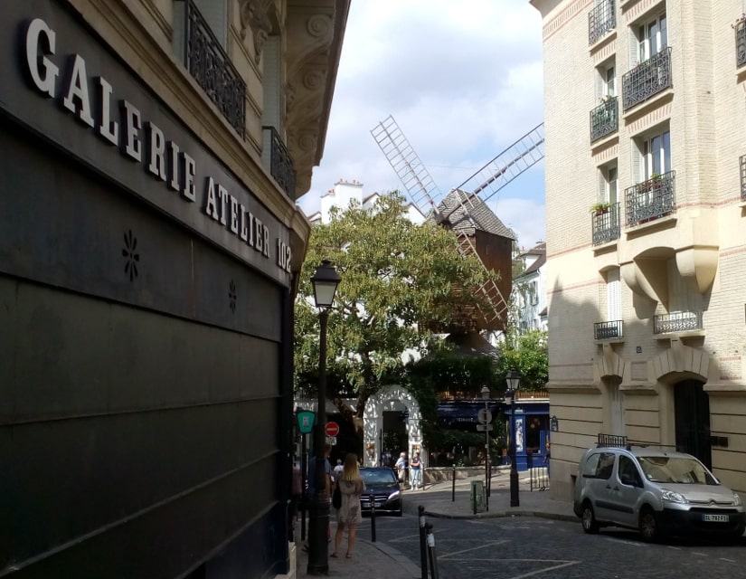A view of the Radet windmill in the distance from Rue Lepic Paris 75018
