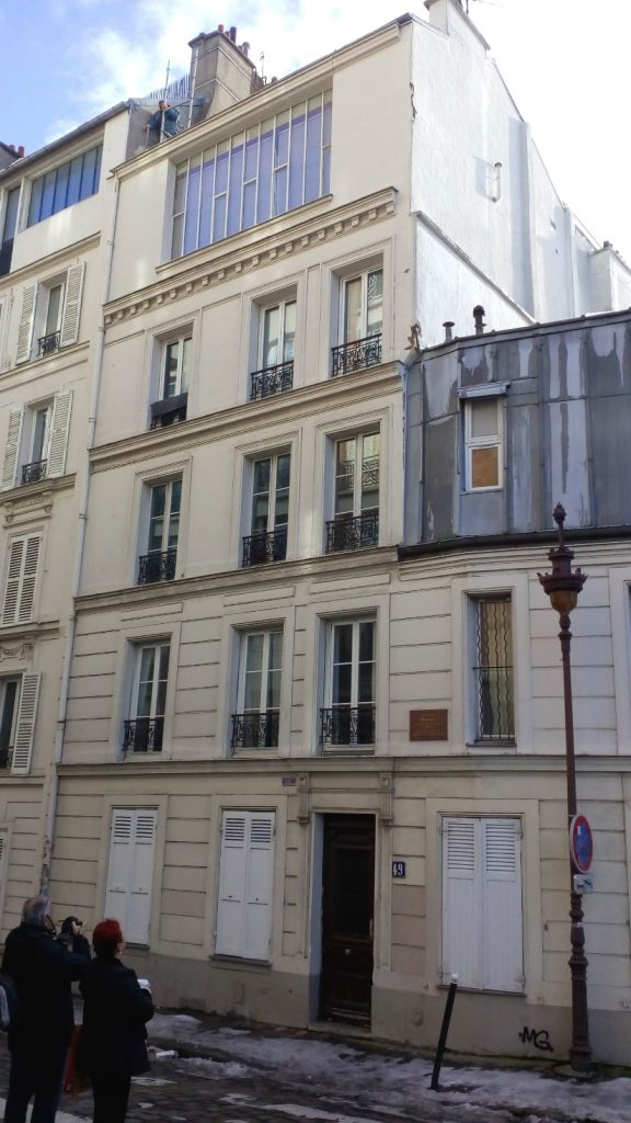 Tourists pause to look up and take a picture of Picasso's first residential studio in Montmartre. The four storey building is about 200 meters from the more famous Bateau Lavoir studios. It is situated 49 Rue Gabrielle Paris 75018.