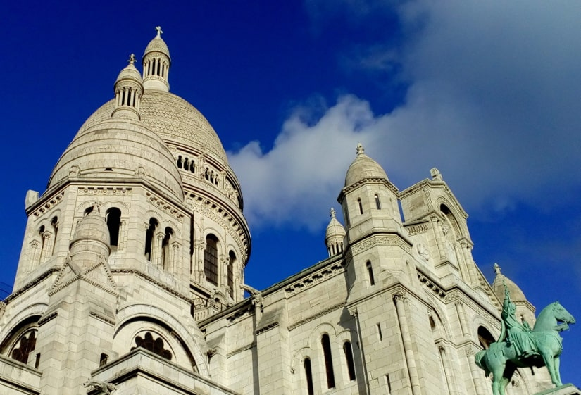 A detail of the dome of the Sacré Coeur Basilica Montmartre. Bright blue sky in background.