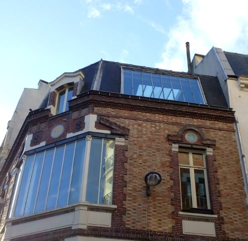 Detail of a building 7 Rue Tourlaque Paris 75018 showing a large window which forms the junction with rue Tourlaque. Toulouse Lautrec had a studio here in 1880s and 1890s.