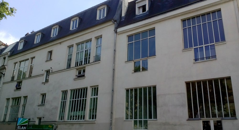 A view of the studio windows and large facade of 11 Boulevard de Clichy Montmartre. This is the studio where, along with Georges Braque, Picasso developed Cubism.