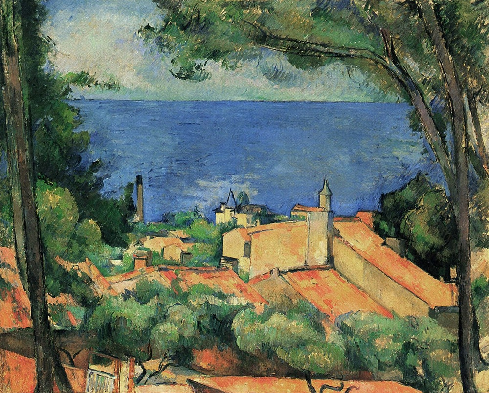 One of Paul Cézanne's many studies of the southern French town of L'Estaque. Some blocky ochre buildings with red roofs are simply evoked. The scene is framed by two large trees. In the distance a blue and turquoise sea with beyond that a vague green and yellow area which suggests adjacent land.