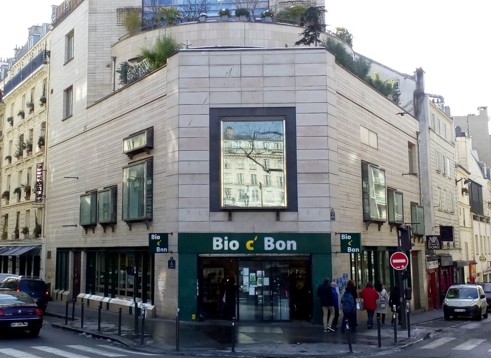 The Bio c' Bon health food store on Place Pigalle, Montmartre. This is the site on the angle of Rue Jean-Baptiste Pigalle and Rue Frochot of the demolished Nouvelle Athènes (New Athens) café; an important meeting point for the Montmartre artistic community it later became a jazz venue.