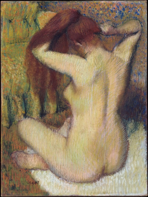 Degas' Woman Combing Her Hair. A female bather figure dries her long auburn hair hair. We see a back three-quarter view. The work is executed in pastel with the contours of the bather's back and hips designed in a light green over pink and white skin.